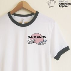 Halsey is the BADDEST! Rep this super cool ringer tee.  We use authentic American Apparel ringer tees.  Our ringer tees are a staple to any girl's closet, adding a touch of  grunge. They look great styled casually with jeans and boots, or dressed up  with a cute plaid skirt.  Unlike other Poly-Cotton t-shirts on the market, ours is made with combed  cotton, giving it an ultra soft, worn in feel and superior drape.  AMERICAN APPAREL WHITE RINGER TEES  Poly-Cotton (50% Polyester / 50%…