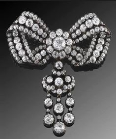 A sévigné is a type of bow brooch which was popular in the 17th and 18th centuries and named for a member of the French Court of Louis XIV, Marie de Rabutin-Chantal, Marquise de Sévigné (1626 - 1696). It was originally a flat, symmetrical ribbon bow which was worn centered low on the bodice. and has evolved through the years.