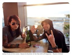 Ashley and CC won bassist and drummer of 2013 in AP Magazine. This is them celebrating at the beach.
