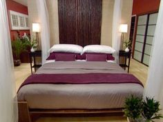 A custom bed is the focal point in a contemporary, Asian-style bedroom. From the experts at HGTV.com.