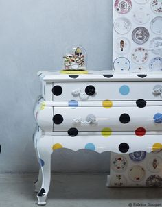 i could do this! vintage nightstand+white lacquer paint+multiple small cans of paint+circle stencil :)