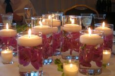 Flowers in water under Candle