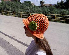 crochet / hat / flower / children / ideas / yarns / hooks / stitches / children / ideas / beautiful / gift / crafts / summer / sun hat / spring / cotton / handmade / etsy /  orange / green