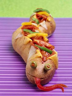 Main Dish: Slithering Snakewich  Oozing with yummy pizza ingredients, this overstuffed snake sports a sinister smile and a long, forked tongue.