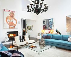 Love the couch and all of the accessories in this room - minus the playboy poster, of ource.