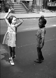Two little kids dancing on the streets of New York City, c. 1940.