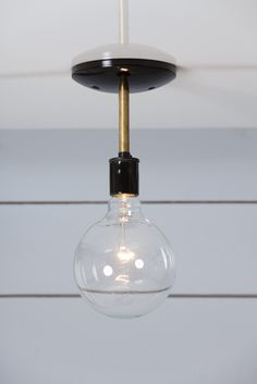 Semi Flush Mount Brass Ceiling Light   $45  -Ceramic Socket in Black or White (250V Max) -Black or White Ceiling Canopy -3in Long X 1/4in Wide Steel or Brass Pipe  Can be mounted on the Ceiling or Wall.  Dimensions Ceiling Canopy- 5in Wide with Universal Mount  http://www.industriallightelectric.com/collections/industrial-ceiling-light/products/brass-steel-semi-flush-mount-ceiling-light