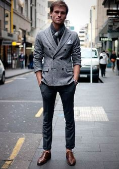 Shop this look on Lookastic:  http://lookastic.com/men/looks/charcoal-scarf-grey-double-breasted-blazer-navy-dress-pants-brown-oxford-shoes/6078  — Charcoal Scarf  — Grey Wool Double Breasted Blazer  — Navy Dress Pants  — Brown Leather Oxford Shoes