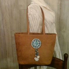 Aztec inspired handbag vegan material Feels like suede but softer. Beading on front is beautiful turquoise and white pearls and beads. Zipper closure. 1 large compartment.  Perfect condition. Bags Hobos