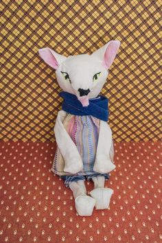 "Cute wolf artist's doll. ""Clothes does make the man."" He is created from recycled muslin with embroidered eyes. All his doll clothes are made from recycled old clothes. // Noisybeak tumblr"