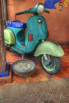 Vespa in South of the Border pastels...the rough texture of the paint and the contrasting colors makes this one very memorable. As much fun to look at as to ride....