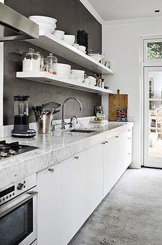 White kitchen, grey wall, marble countertop, open shelves