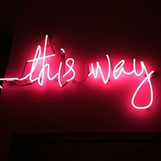 'This way' neon sign