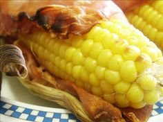 Bacon Wrapped Grilled Corn on the Cob from Food.com:   The ultimate decadent corn on the cob;. based on a recipe from Paula Deen, of course.  :)  The flavor the bacon gives the corn is outstanding!  Prep time includes soaking.