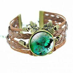Abessina műbőr szíjas pillangó mintázatú üveglencsés karkötő Hosszúság: 18+5 cm Anyaga: műbőr + fém ötvözet