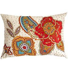 I like this floral accented pillow, it has just the right amount of color pop.