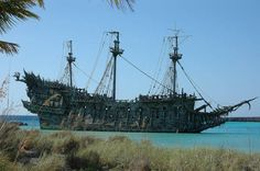 Castaway Cay, Bahamas. The Flying Dutchman from the Pirates of the Caribbean movie lies just offshore.