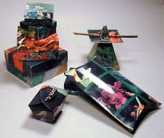 origami boxes, some made from old calendar pages... Nice gift-box idea