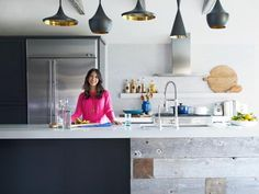 """The+island's+base+is+half+wood+cabinetry+painted+dark+gray+(try+Sled+by+Behr)+and+half+unpainted+reclaimed+wood+from+a+farm+in+Wisconsin.+The+countertops+are+solid+white+Caesarstone,+and+they+couldn't+be+easier+to+clean:+just+wipe+them+down+with+soap+and+water.+""""The+kitchen+was+beautiful,+but+it+had+a+stark+feeling+with+the+white+tile,+stainless+steel+and+white+counters,""""+says+Emily.+""""My+job+in+this+room+was+more+about+styling+tricks+than+decorating."""""""