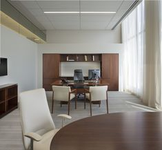 Each private office features a custom built-in workwall, meeting table, bookcase, and sit-to-stand desk. Office Table, Office Decor, Home Office, Office Spaces, Executive Room, Executive Suites, Corporate Interiors, Office Interiors, Contemporary Office