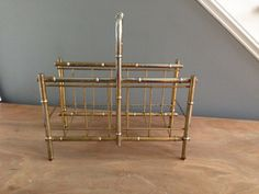 Fabulous vintage Hollywood Regency 1960s faux bamboo magazine rack in a gorgeous brass tone finish- wonderful age and patina.  Perfect for your