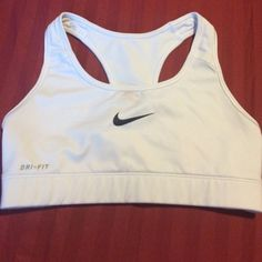 Nike Sports Bra White Nike sports bra, size XS, worn once(too small for me), stain free Nike Intimates & Sleepwear Bras