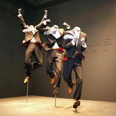 "Now, that's energetic!  Love the styling details (flying ties, etc) that support the mannequins'  ""action""."