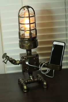 "Handmade ""industrial robot"" lamp design with functioning outlet/USB and switch. This lamp is handmade in my Brooklyn studio. Gadgets Steampunk, Lampe Steampunk, Steampunk House, Industrial Robots, Industrial Pipe, Industrial Lighting, Pipe Lighting, Cool Lamps, Iron Pipe"