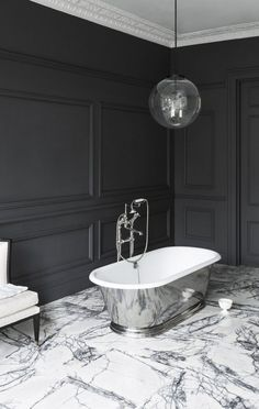 Monochrome bathroom with marble flooring, chrome freestanding bathtub and dark grey wooden panelling painted in Perse by Paint and Paper Library Bathroom Vanity Designs, Mold In Bathroom, Best Bathroom Vanities, Bathroom Trends, Bathroom Interior Design, Bathroom Ideas, Bathroom Tubs, Bathroom Organization, Shades Of Grey Paint