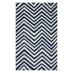 Hand-hooked indoor/outdoor rug with a chevron motif.   Product: RugConstruction Material: 100% PolypropyleneColor: NavyFeatures:  Hand-hookedSuitable for indoor or outdoor use Note: Please be aware that actual colors may vary from those shown on your screen. Accent rugs may also not show the entire pattern that the corresponding area rugs have.Cleaning and Care: Spot treat with a mild detergent and water.  Professional cleaning is recommended.