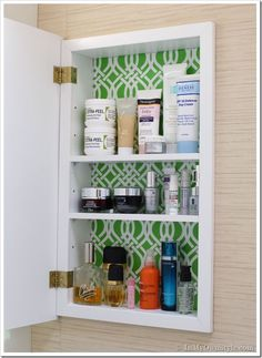 LOVE this idea! line medicine cabinet with wrapping paper + clear contact paper (or patterned contact paper)