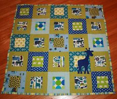 """Blue, tan, and green jungle animals baby quilt with appliqued giraffe.  Pattern and colors are Oh Fransson's """"Simply Modern baby Quilt"""""""