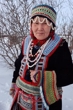 East Siberia ~ Russia | Ekaterina, an Even woman from Gizhiga, wearing traditional Even dress. Northern Evensk, Magadan Region | © Bryan & Cherry Alexander Photography