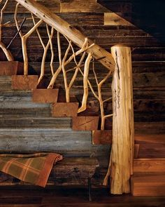 The Adirondacks country house's main staircase railing is crafted from tree branches and logs. Notice the use of a variety of natural woods in the unfinished wood walls and the rough hewn wood block stairs. A MOUNTAIN LAKE COUNTRY HOUSE & LONG BARN Stair Railing, Wood Staircase, Staircase Design, Diy Stair, Wood Handrail, Porch Railings, Railing Ideas, Cabins In The Woods, Log Homes