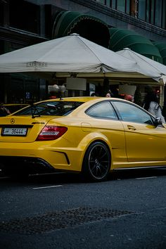 Tune in to tunecarstyle.com for the best auto accessories available!   #cars #AMG #Mercedes #yellow #luxury