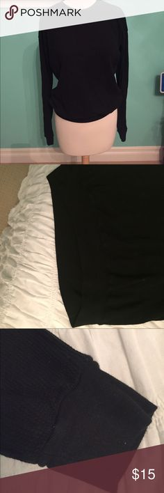 Brandy Melville black waffle long sleeve tee Great condition waffle long sleeve Brandy Melville with crew neck, band around bottom and sleeve band. Very soft and comfortable and OSFA but more generous fitting than most Brandy. From smoke and pet free home. Brandy Melville Tops Tees - Long Sleeve