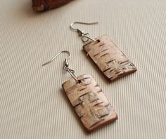 love these!  birch bark  earrings. . . handmade wooden by WoodsOfNarnia on Etsy, $16.00