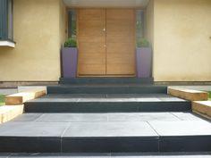 Black limestone paving with planters