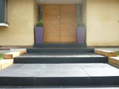 Black limestone paving with planters