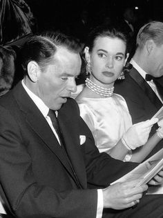 Glamour Girl: Gloria Vanderbilt with Frank Sinatra-date? If looks could kill, Frank would have been clocked out!