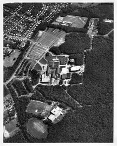 Large area aerial photograph of George Mason University, Fairfax campus, dated September 22, 1974. Photograph depicts, construction of Academic II A (today's Robinson Hall A) and the University Union (today's Student Union I Building), the Fenwick Library, Lecture Hall, Finley, South, East, and West Buildings, Thompson Hall, Physical Education Building with fields, and parking area. Copyright George Mason University
