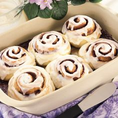 Giant Cinnamon Rolls - The Pampered Chef® Dough1 package (16 ounces) hot roll mix (including yeast packet)1 cup very warm water (120°F-130°F)2 tablespoons butter or margarine, softened1   eggFilling1/4 cup butter or margarine, softened1/4 cup granulated sugar1/4 cup packed brown sugar2 tablespoons Korintje Cinnamon1 tablespoon light corn syrupFrosting2 ounces cream cheese, softened2 tablespoons butter or margarine, softened1/2 teaspoon vanilla1 1/3 cups powdered sugar1 tablespoon milk
