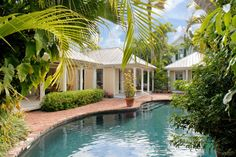 Key West Rentals - 4BR 3.5BA - Sleeps 8 Heated Oasis Swimming Pool Private Manicured Pool Garden Little lane in the Heart of Old Town Key West Few places exist where you can ride the fine line separating a secluded tranquil luxury villa, and the Heart of Old Town Key West. It may sound like a poetic abstraction, but for this masterful property with 5-Star amenities, the distinction is definitely real.