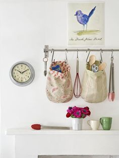 Fabric Kitchen storage bags. I like the idea of hanging the utensils by themselves if you do not have enough space in your kitchen.