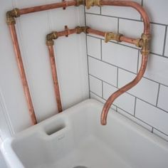 Industrial DIY mixer tap in downstairs WC: 15mm copper pipe with brass fittings and brass gas valve taps over belfast sink