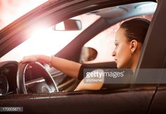 Stock Photo : Young woman driving a car.