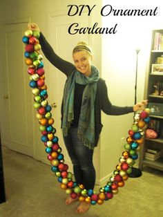 """Christmas Decorating DIY Projects: Create a beautiful garland out of colorful ornaments by simply looping ribbon through the ornaments. I love how """"chunky"""" this garland looks. And those colors!"""