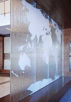 "Benedictine University - Lisle, IL Glass Description: Feature Wall 1/2"" Starphire Tempered Kiln-Fired Glass Texture: MD213 Rigo Custom Etched World Map on Textured Side"