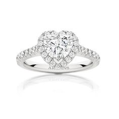 Fine delicate detail of this round brilliant cut diamond halo engagement ring truly exposes the centre heart diamond as the main feature. Having fine mellè round brilliant diamond solest set the centre stone and through the band handmade in platinum. See more at http://www.armansfinejewellery.com/engagement-rings