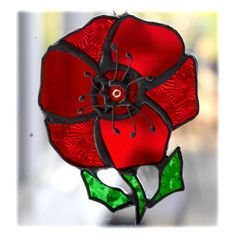 This is one of my favourite designs - a poppy - a stained glass suncatcher made using the Tiffany copper foil technique. A gorgeous flower made from 3 different types of red glass, textured and plain to give the , flower movement. Types Of Red, Red Glass, Shades Of Red, Flower Making, Suncatchers, Red Flowers, Different Colors, Christmas Time, Poppy